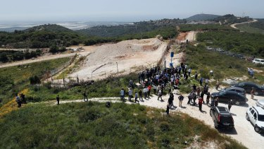 Journalists gather at a border point in south Lebanon last week, during a media trip organised by Hezbollah to show the defensive measures established by Israel to prevent against Hezbollah infiltration.