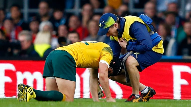 In a world of pain: Matt Giteau after a tackle went wrong.