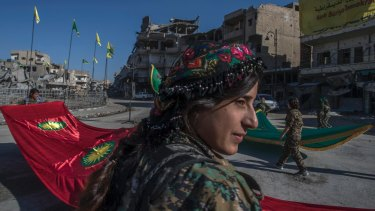 Fighters from the Kurdish female militia, the Women's Protection Units, or YPJ, hold a celebration in Paradise Square in Raqqa, Syria, last October.