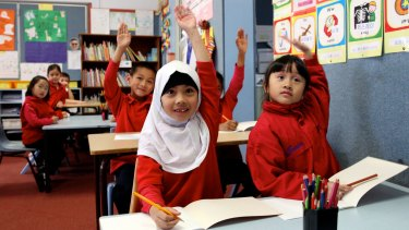 Sandra Morales (left) at a bilingual program at Campsie Public School. She speaks Indonesia, Korean and English.