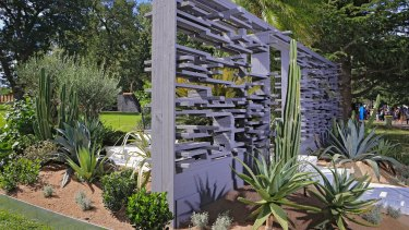 Myles Baldwin's succulent-strewn garden featured a faux breeze-block front.
