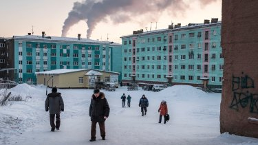 People on the streets in Dudinka, Russia, a small port city on the Yenisei River and the main transportation hub for the palladium, nickel, copper and other metals produced in nearby Norilsk.