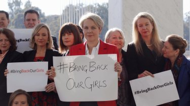 Concerned MPs, including Shadow foreign minister Tanya Plibersek, display #bringbackourgirls signs outside Parliament House in Canberra in 2014.
