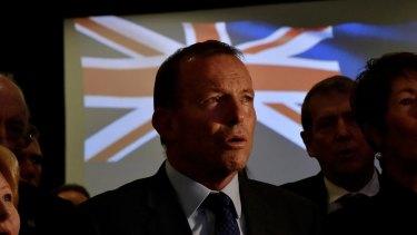 Former prime minister Tony Abbott sings the national anthem.