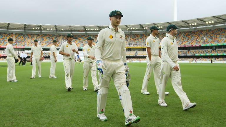 Rain, rain go away: The Australian team leave the field as weather delays play on day four.