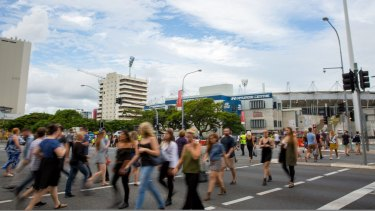 Adele fans cross the road to the Gabba on March 4.