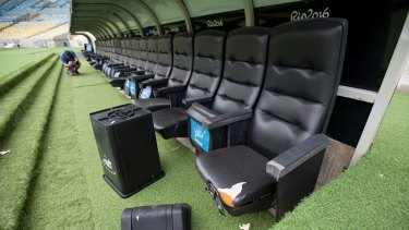 A rubbish bin and ripped seats at one of the dugouts in Rio's world-famous Maracana stadium.