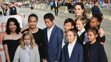 Vivienne Jolie-Pitt, front row from left, Knox Jolie-Pitt, Sareum Srey Moch, middle row from left, Loung Ung, Maddox Jolie-Pitt, Pax Jolie-Pitt, Kimhak Mun, Shiloh Jolie-Pitt, Zahara Jolie-Pitt and Angelina Jolie at the premiere of 'First They Killed My Father' at the Toronto International Film Festival.