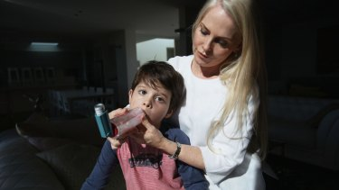 Air flow: Michelle Donegan helps her son Zac Shahidi, 4, take his asthma medication.