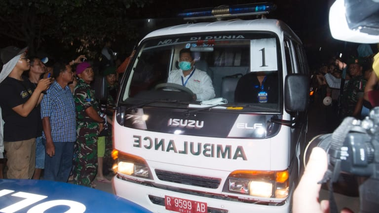 One of the ambulances carrying a coffin of one of the executed leaving Wijaya Pura in Cilacap.