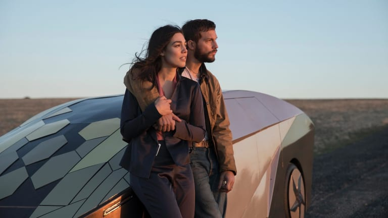 Before the crash: Melanie Vallejo as Asha Trace and Logan Marshall-Green as Grey Trace.