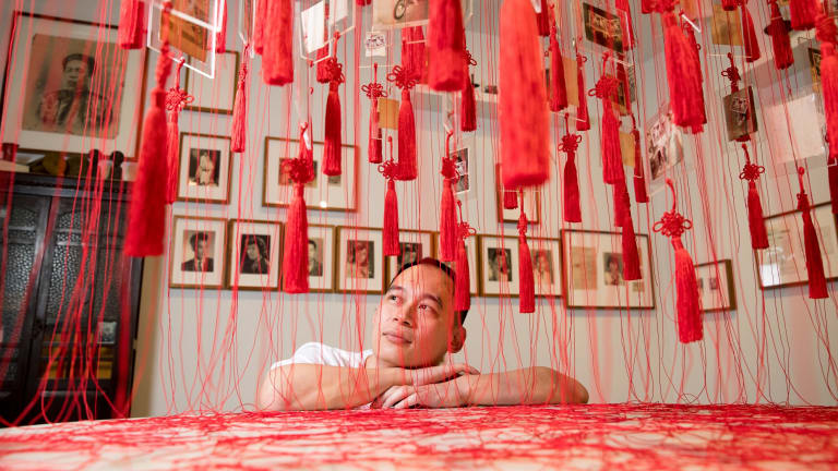 Phuong Ngo, with his work, Colony, at the Museum of Contemporary Art.