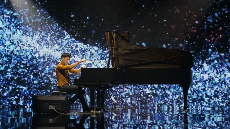 Maksim Mrvica on stage.
