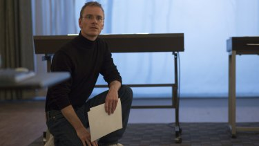 Michael Fassbender is in his element as a God complex that needs more office space in <i>Steve Jobs</i>.