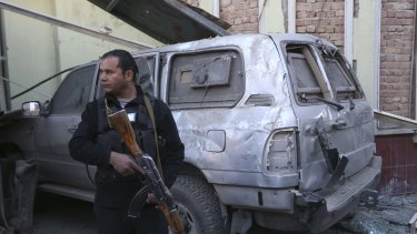An Afghan security forces member stands guard at the Spanish Embassy after the Taliban attack in Kabul last week.