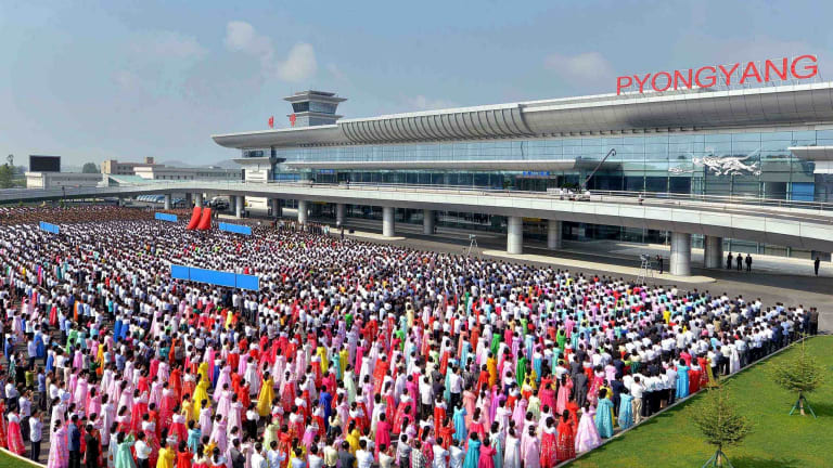 People attend the opening ceremony for the newly built terminal of Pyongyang International Airport in this undated picture released on Wednesday.
