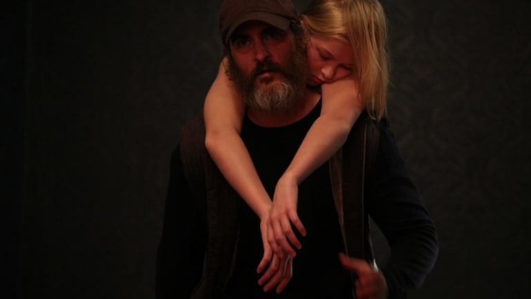 Joaquin Phoenix as Joe and Ekaterina Samsonov, who has been kidnapped,  in You Were Never Really Here.