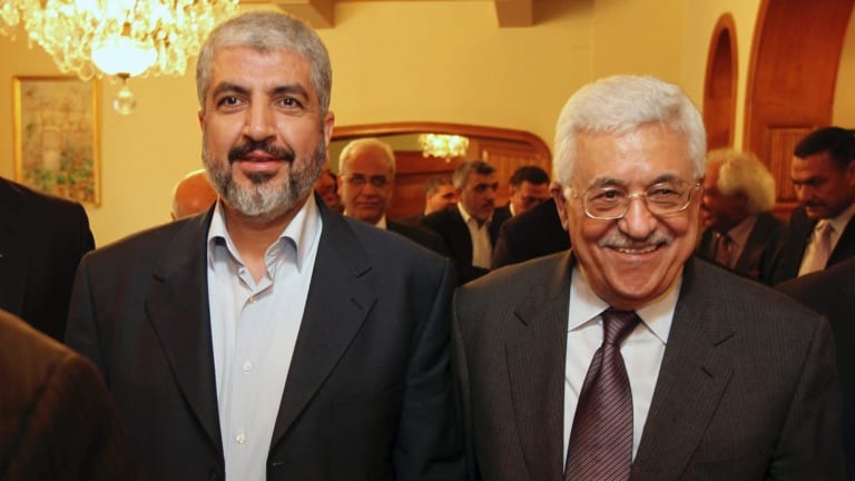 Hamas leader Khaled Mashaal, left, and Palestinian Authority president Mahmoud Abbas are seen together during a meeting in Cairo in 2011.