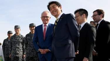 Australian Prime Minister Malcolm Turnbull and Japanese Prime Minister Shinzo Abe inspect the Patriot Missile system and Australian made Bushmaster Protected Mobility vehicle at a Japan Ground Self Defence Force base at Narashino, Japan.