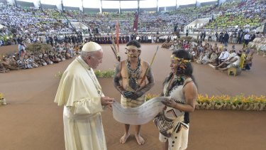 Thousands of indigenous people watch Pope Francis in Puerto Donaldo, Peru.