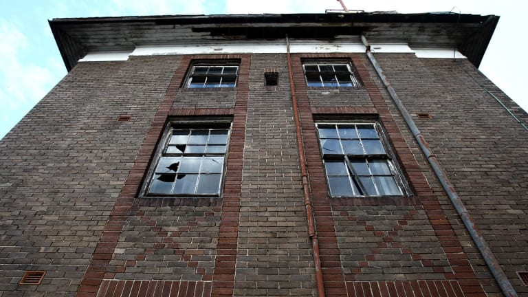 A derelict Bureau of Meteorology building soon to be handed to the Education department for renovation.
