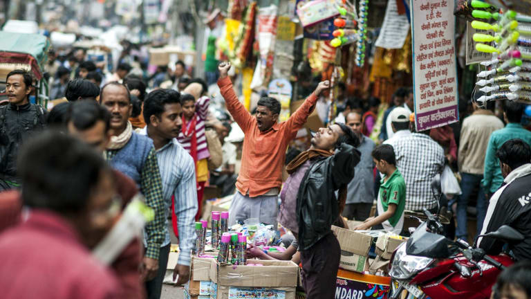 Salespeople at an open market on the busy streets of Old Delhi.