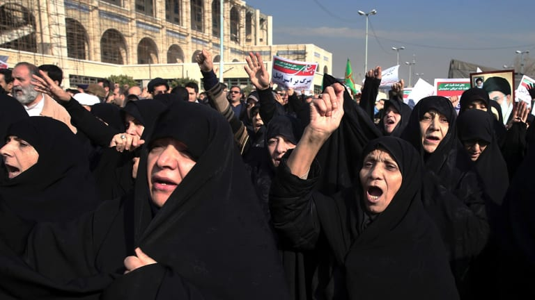 Government supporters chant slogans at a rally in Tehran on Saturday. Iranian hard-liners rallied Saturday to support the country's supreme leader.