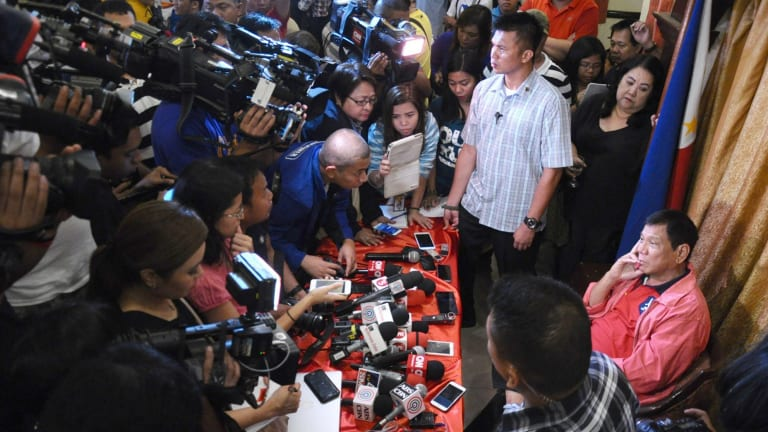 Rodrigo Duterte hols a press conference after being elected president of the Philippines on May 26.