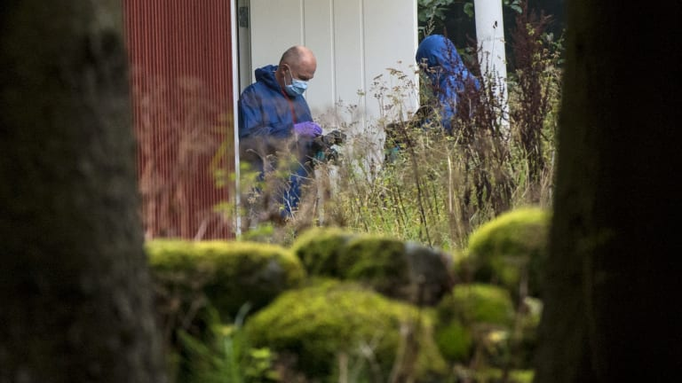 Police forensic officers work at a property outside Knislinge in southern Sweden connected with the abduction case.