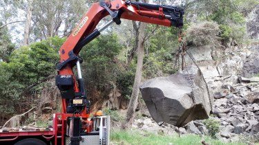 This rock specimen from Bowral's Mt Gibraltar starts its journey to the Canberra Rock Garden.
