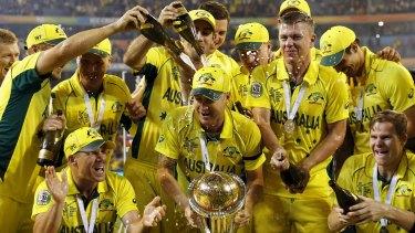 Australian captain Michael Clarke's teammates drench him with alcohol as they celebrate winning the World Cup.