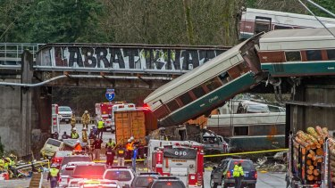 Cars from an Amtrak train that derailed lie spilled onto Interstate 5, in DuPont, Washington, last month.