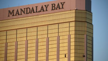 Two hotel employees had called for help and reported that gunman Stephen Paddock sprayed a hallway with bullets, striking an unarmed security guard in the leg.