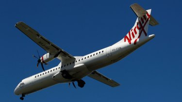 An ATR 72-600 aircraft operated by Virgin Australia prepares to land at Sydney Airport.