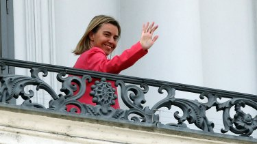 European Union High Representative Federica Mogherini waves on Monday from a balcony of the Palais Coburg where closed-door nuclear talks with Iran continue.