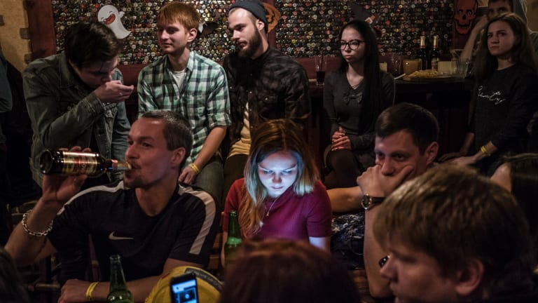 Young people listen to a rock band at the popular Zaboi (The Face) bar, the only establishment in the city that has its own brewery, in Norilsk, Russia.