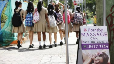 Case dismissed: Pupils from Hornsby Girls' High School walk past a massage parlour that won a legal battle with the council.
