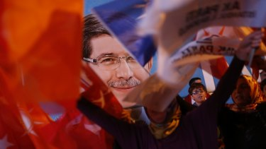 A poster of Turkey's prime minister and leader of the Justice and Development Party (AKP) Ahmet Davutoglu on Sunday.
