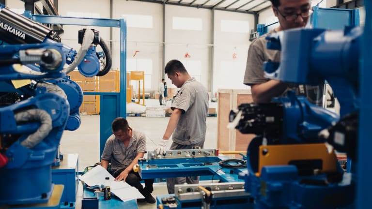 Workers assembling robots at a factory in Shenyang. Beijing hopes to dominate cutting-edge technologies like artificial intelligence.