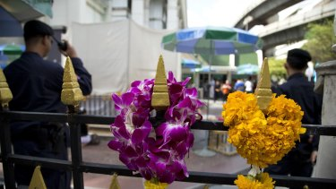 Police keep watch at the Erawan Shrine, the scene of the August 17 bombing, in Bangkok.