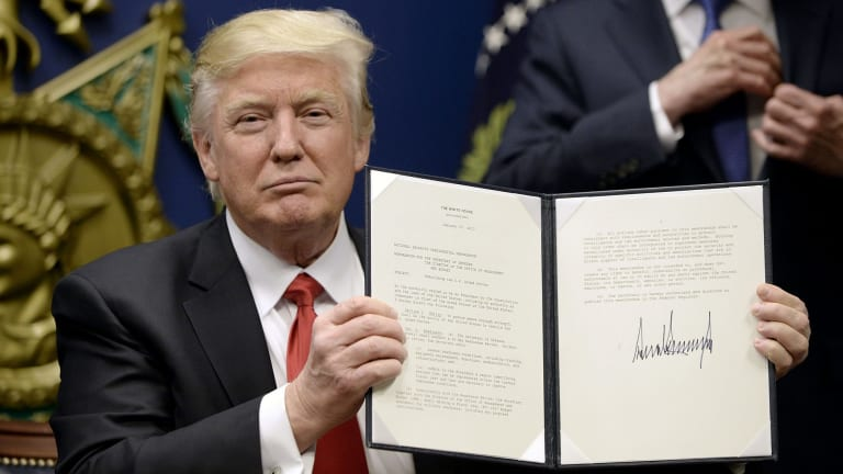 US President Donald Trump after signing the first executive order banning refugees and people from some Muslim-majority countries.