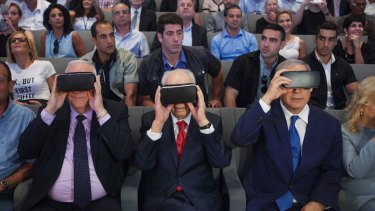 Israeli President Reuven Rivlin, left, Shimon Peres, centre and Israeli Prime Minister Benjamin Netanyahu, wear virtual reality goggles during a ceremony at the Peres Centre for Peace in Jaffa in July.