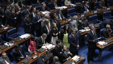 A line of senators form behind Brazil's former President Fernando Collor de Mello, for a chance to speak at the final session in the impeachment trial.