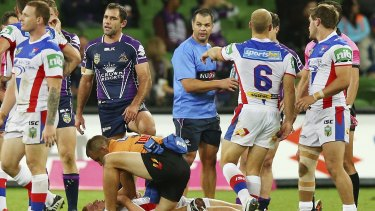Turbulent times: The fateful tackle that left Alex McKinnon in a wheelchair.