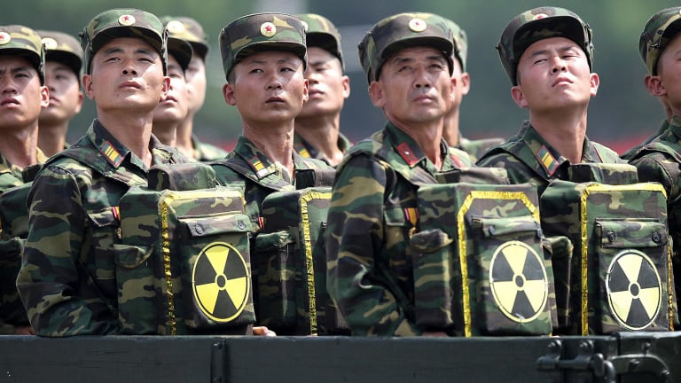 North Korean soldiers carrying packs marked with the nuclear symbol during a 2013 military parade in Pyongyang.