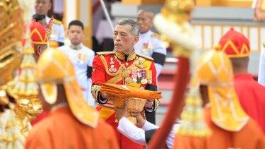 Thailand's King Maha Vajiralongkorn takes part in the funeral of his father, King Bhumibol Adulyadej in Bangkok on Thursday.