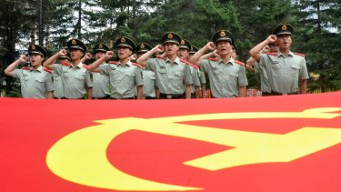 Chinese paramilitary policemen pledge loyalty to the Communist Party as they observe the 94th anniversary of the founding of the Communist Party of China on July 1.