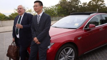Clive Palmer and senator Zhenya 'Dio' Wang outside Parliament House.