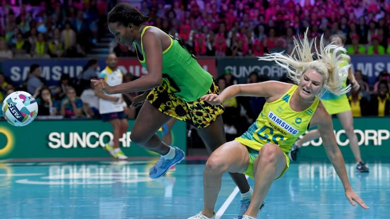 Gretel Tippett of Australia clashes with Stacian Facey of Jamaica.
