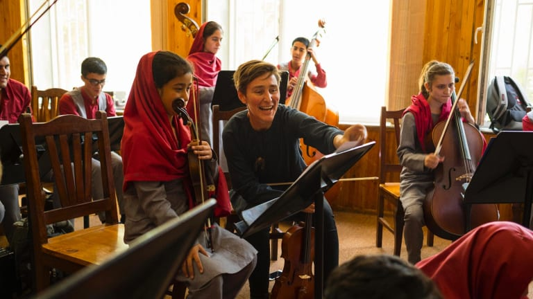 """Ayres at Kabul's Afghanistan National Institute of Music in June. When he arrived in 2015, he was startled by how much it bothered him when students called him """"Miss Emma"""": """"I'd weep at being stuck in this female body."""""""